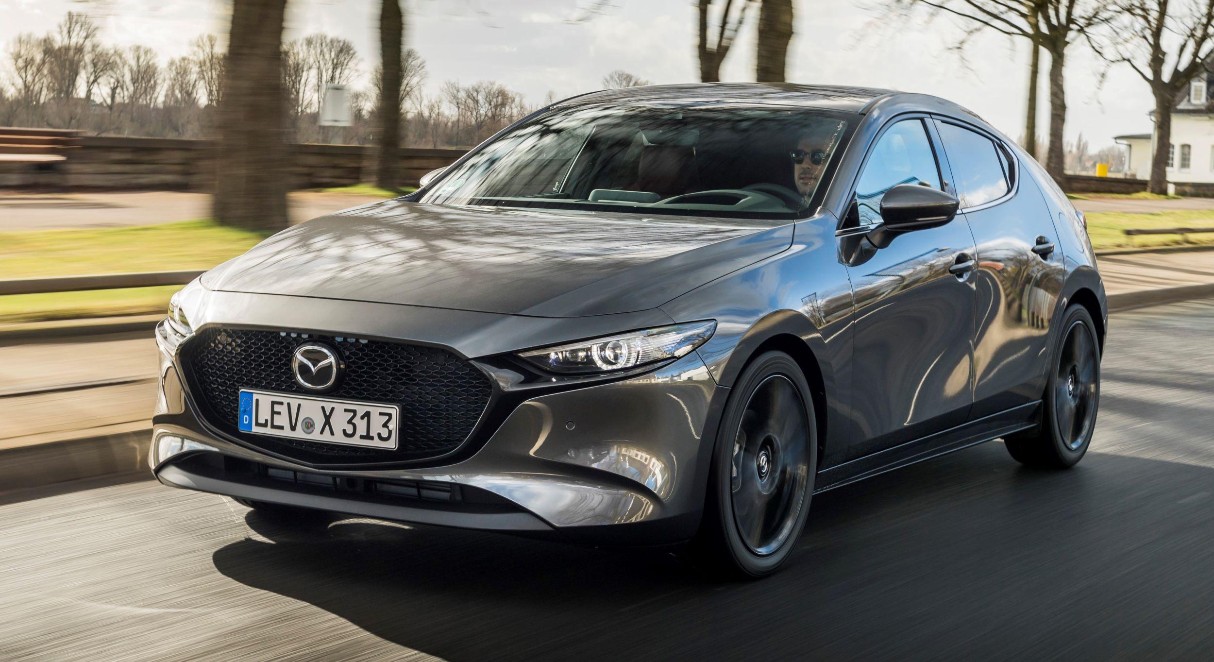 2021-Mazda3-Machine-Grey,-Action-01