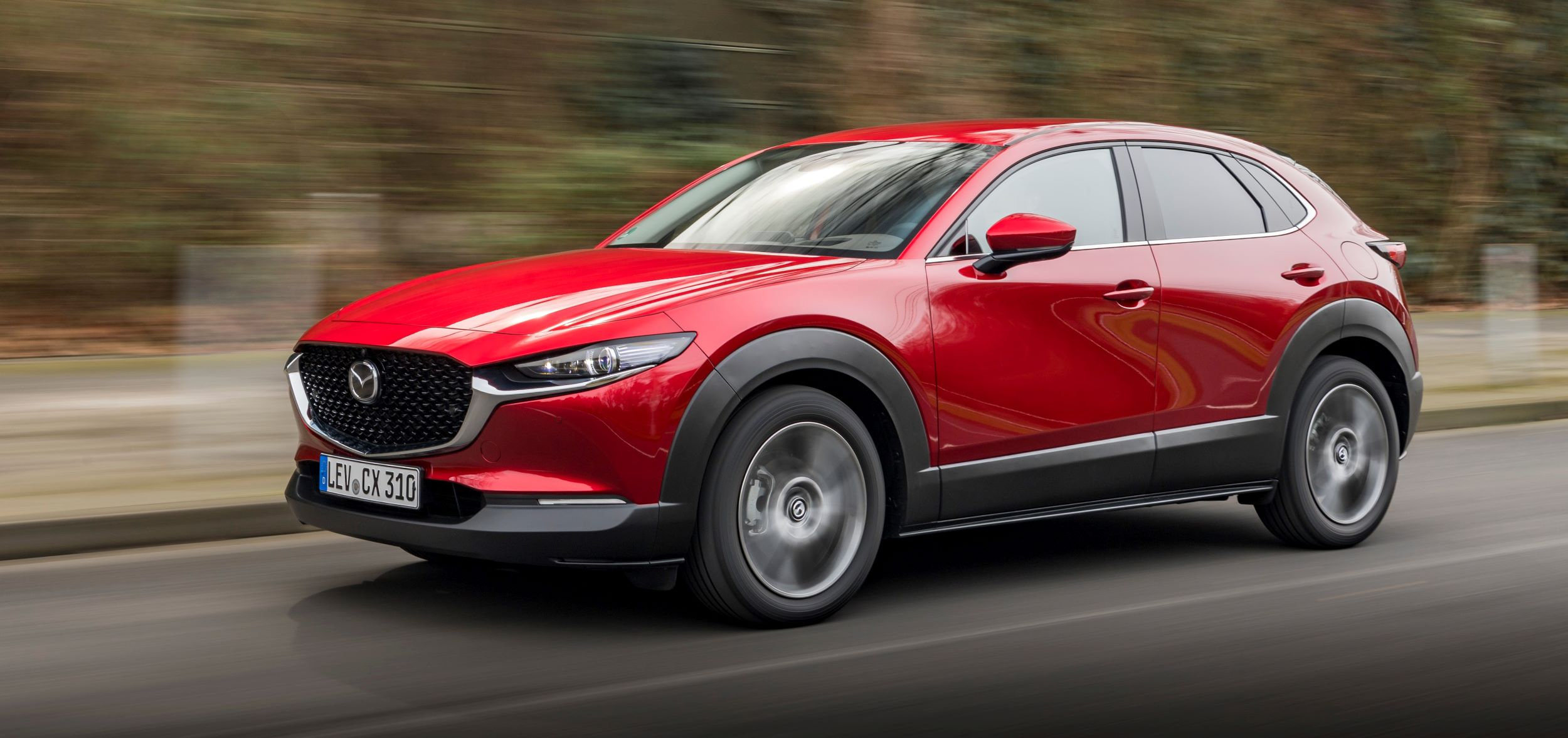 2021-Mazda-CX-30-Soul-Red-Crystal,-Action-05
