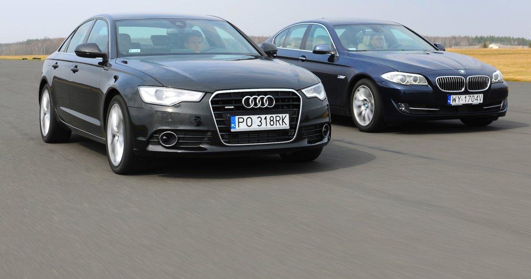 Jadące BMW serii 5 i Audi A6