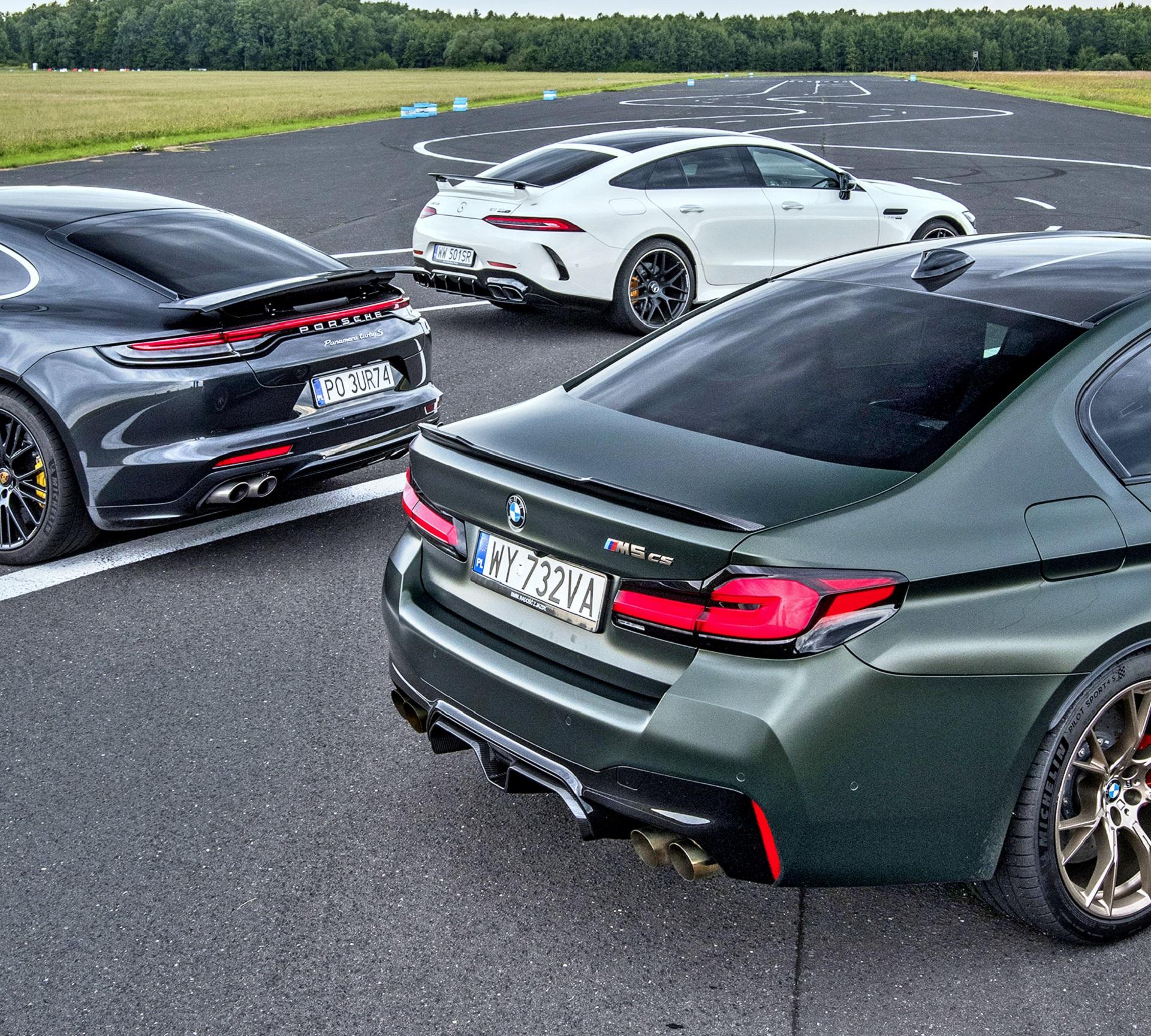 BMW M5 CS, Mercedes-AMG GT 4d 63 S, Porsche Panamera Turbo S - tyły